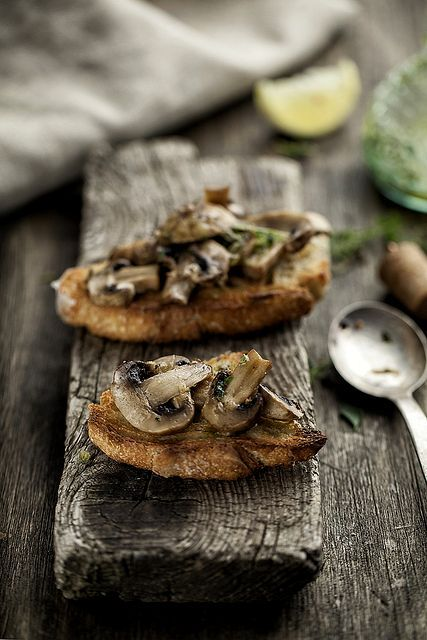 Oven baked mushrooms with lemon and thyme by Mikeyarmish on Flickr.