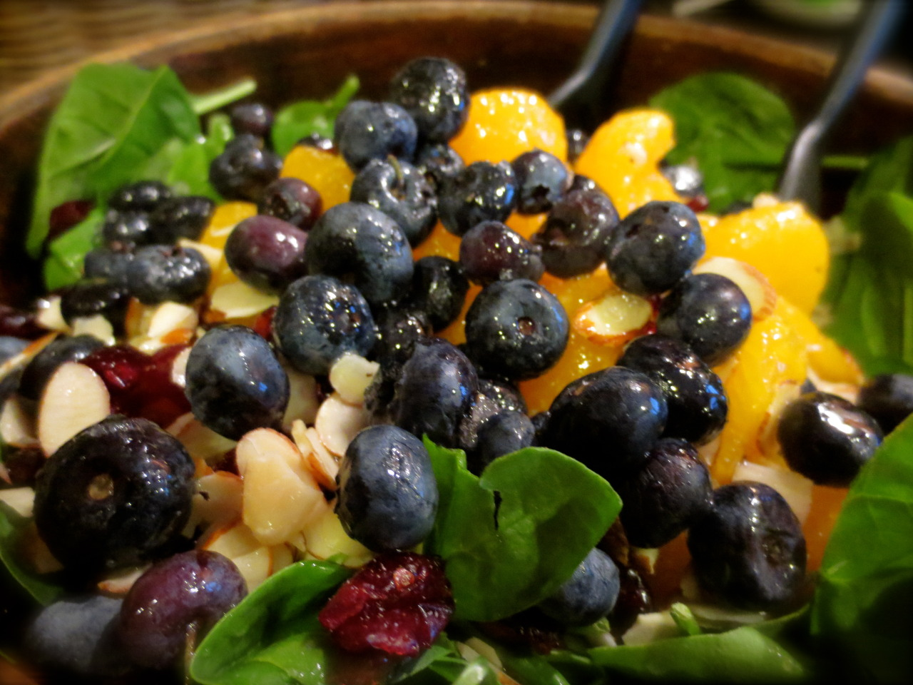 A delicious summer salad my family makes. Spinach with blueberries, craisins, mandarin oranges, and slivered almonds. Topped with a homemade dressing.More at secretsofanamateurchef.tumblr.com